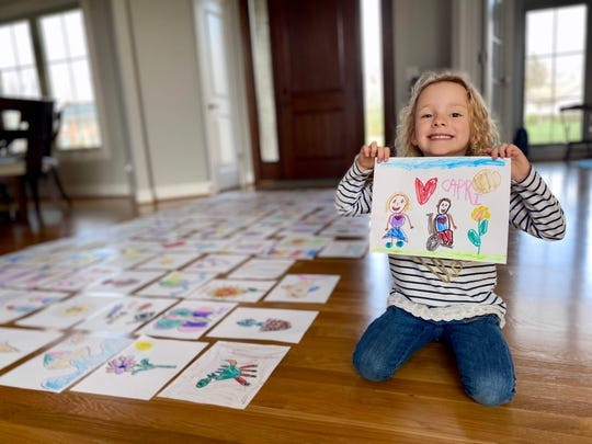 Kelly Larbes and her daughter Capri, 5, have created more than 90 drawings for residents at Madeira Village Nursing Home in Cincinnati, OH.