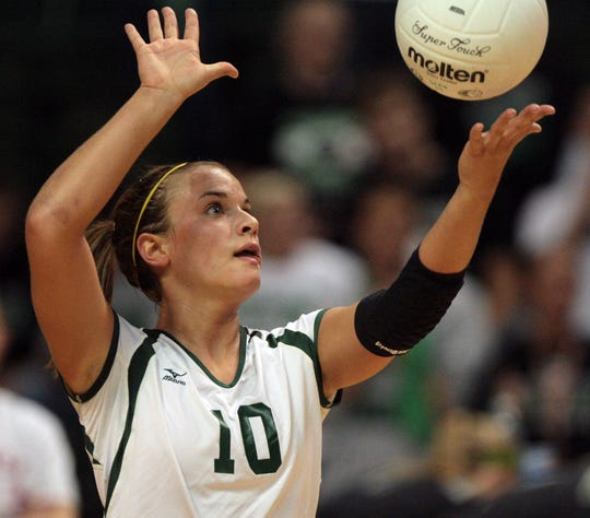 Ursuline Academy's Kori Moster serves on Saturday, Nov. 14, 2009, during play in the Division I state finals in Dayton with Dublin Coffman.