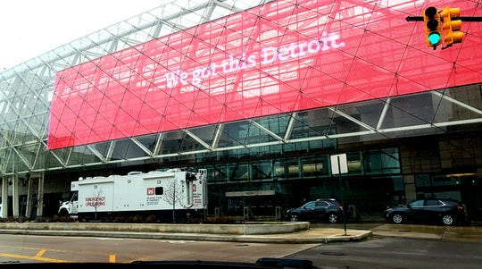A U.S. Army Corps of Engineers emergency operations  truck is parked outside the TCF Center in downtown Detroit Saturday, March 28, 2020.