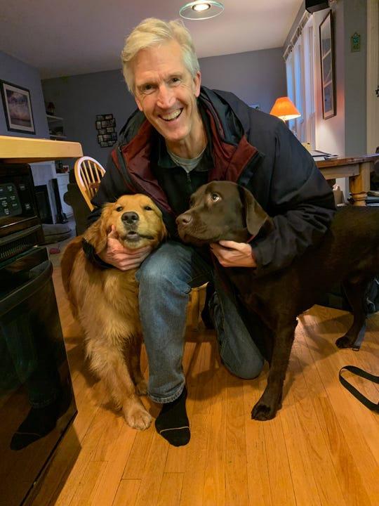 Tigers radio play-by-play man Dan Dickerson after walking his two dogs Saturday.