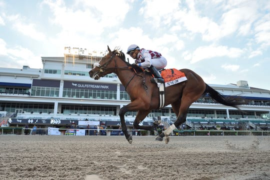 In this image provided by Gulfstream Park, Tiz the Law, ridden by Manuel Franco, wins the Florida Derby horse race at Gulfstream Park on Saturday.