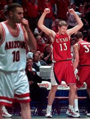 Utah's Hanno Mottola celebrates as the final seconds run out in Utah's win over Arizona in the NCAA West Regional final in 1998.