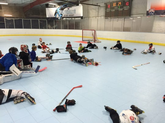 Young roller hockey players participate in a skills clinic put on by Joe Dumars Fieldhouse.