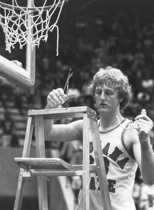 Larry Bird cuts down the net after Indiana State University won the championship game in the Missouri Valley tournament on March 3, 1979. Bird suffered a triple hairline fracture of his left thumb in the game. That year ISU faced Michigan State in the NCAA finals but lost to the Spartans (and Magic Johnson) on March 26,1979,in Salt Lake City.