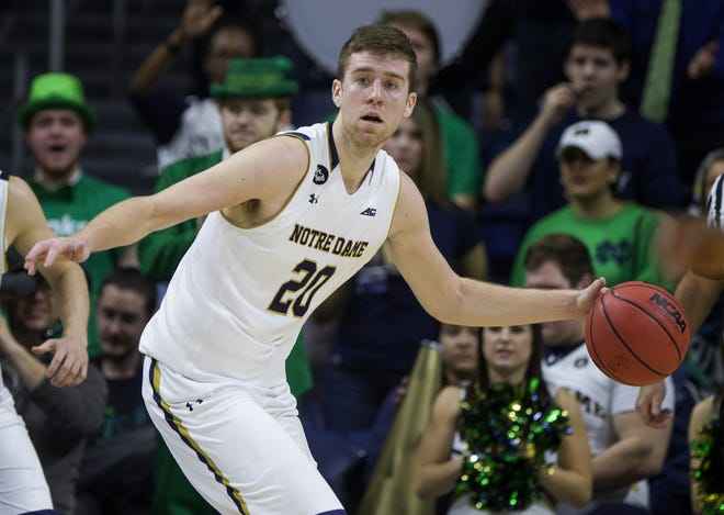 Notre Dame's Austin Burgett (20) looks downcourt as he turns the ball during the second half of Notre Dame's 85-62 win over Wake Forest in an NCAA college basketball game Sunday, Jan. 31, 2016, in South Bend, Ind.