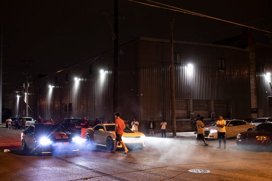 Competitors await the start of the next drag race down 13th Street on Saturday night in Louisville. March 28, 2020