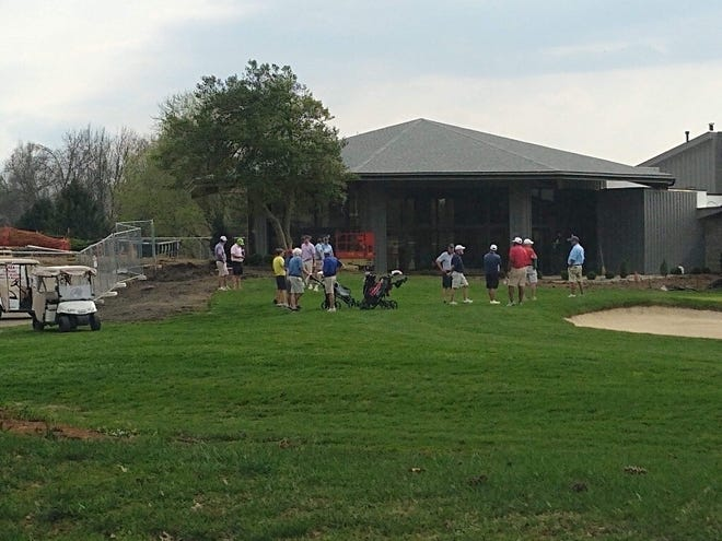 Golfers spend time in groups at Hunting Creek Country Club despite the social distancing order.