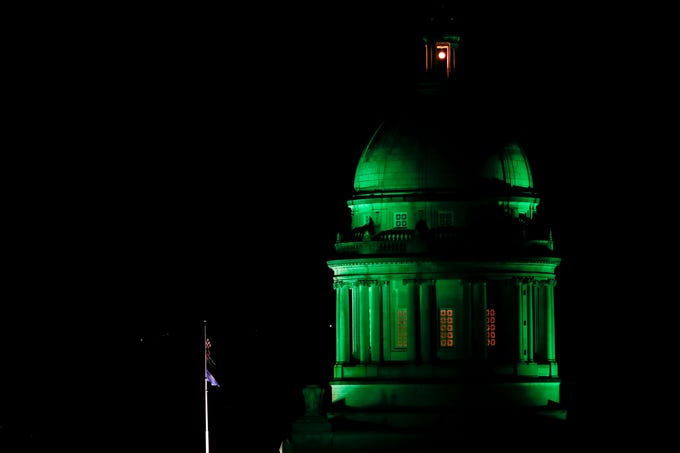 The Kentucky State Capitol is lit in green on March 27, 2020 in honor of the people from the state who have died with the coronavirus. As of this date, the death toll had reached nine³