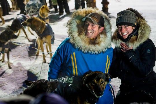 Matthew Failor with his fiancé Liz Raines at the finish line of the Kuskokwim 300 sled dog race.
