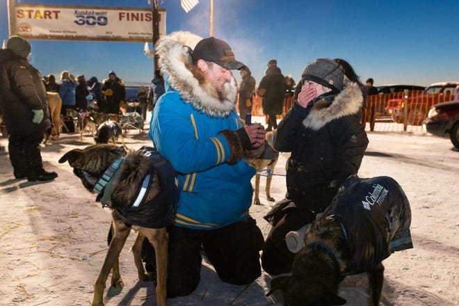 Matthew Failor, a Mansfield native, proposes to his girlfriend Liz Raines at the finish line of the Kuskokwim 300 sled dog race in January.