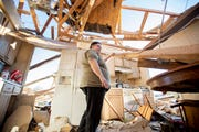 Janie Wewers looks around her home Sunday, March 29, 2020, after it was hit by a tornado the previous night in Jonesboro, Ark. Wewers sheltered in her bathtub during the storm.