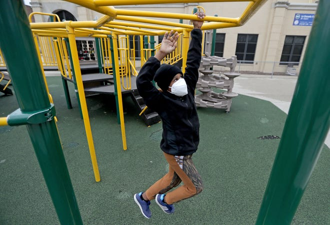 Pierre Bonds, 10, plays on a playground at Fratney Elementary School on North Fratney Street in Milwaukee on March 29, 2020. Schools across the state are rolling out their reopening plans for the 2020-21 school year.