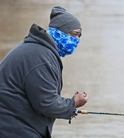 Ivy Moore of Glendale used a balaclava made for fishing to fill in for a medical mask and to keep warm.