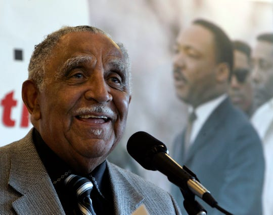 FILE - In this July 2, 2008, file photo, the Rev. Joseph E. Lowery speaks at the National Press Club in Washington. In the background is an image of the Rev. Dr. Martin Luther King Jr. Lowery, a veteran civil rights leader who helped King found the Southern Christian Leadership Conference and fought against racial discrimination, died Friday, March 27, 2020, a family statement said. He was 98.