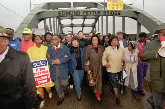U.S. Rep. Cynthia McKinney, D-Ga.; SCLC President Joseph Lowery; Evelyn Lowery; Coretta Scott King, U.S. Rep. Eve Clayton, D-N.C.; and Marie Foster cross the Edmund Pettus Bridge to commemorate the march's 30th anniversary in this 1994 file photo.