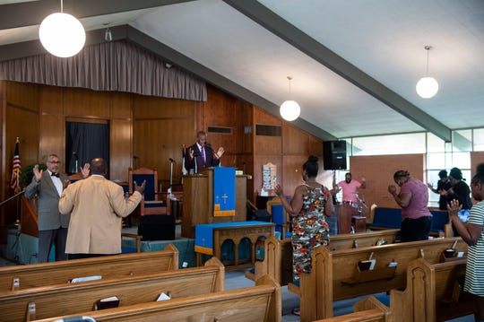 Rev. Willie Broadnax preaches during Sunday morning service at New Birth Missionary Baptist Church in Montgomery, Ala., on Sunday, March 29, 2020.
