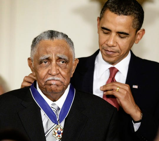 FILE - In this Aug. 12, 2009, file photo, President Barack Obama presents a 2009 Presidential Medal of Freedom to the Rev. Joseph E. Lowery n the East Room of the the White House in Washington. Lowery, a veteran civil rights leader who helped the Rev. Dr. Martin Luther King Jr. found the Southern Christian Leadership Conference and fought against racial discrimination, died Friday, March 27, 2020, a family statement said. He was 98.