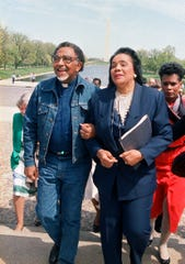FILE - In this April 21, 1988, file photo, Coretta Scott King, widow of the Rev. Dr. Martin Luther King Jr., and the Rev. Joseph E. Lowery, president of the Southern Christian Leadership Conference, walk arm in arm after announcing plans for a rally during a news conference at the Lincoln Memorial in Washington. Lowery, a veteran civil rights leader who helped King Jr. found the SCLC and fought against racial discrimination, died Friday, March 27, 2020, a family statement said. He was 98.