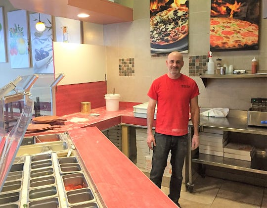 Genova Pizzaria owner Mark Younes managed to smile in the midst of a coronavirus-sparked business downturn.
