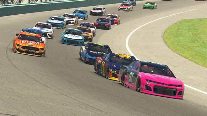 Garrett Smithley (51) leads William Byron and Ty Majeski (inside lane) and Ross Chastain (outside lane) in the eNASCAR iRacing Pro Invitational Series Dixie Vodka 150 virtual race on Sunday, March 22. The series continues throughout the season.