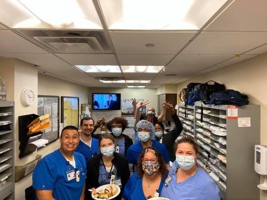 """Staff in the Vassar Brothers Medical Center emergency unit enjoy lunch from the """"Bad Moms of the Hudson Valley."""""""