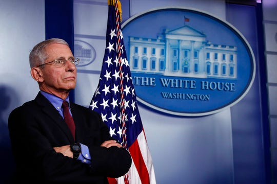 Dr. Anthony Fauci, director of the National Institute of Allergy and Infectious Diseases, listens during a briefing about the coronavirus in the James Brady Press Briefing Room, Friday, March 27, 2020, in Washington. (AP Photo/Alex Brandon)