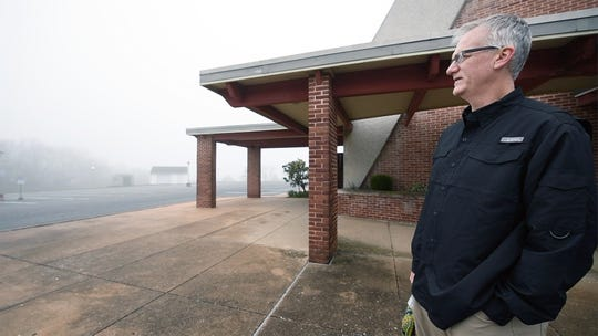 Pastor Tab E. Cosgrove, looks across the foggy parking lot of St. John Lutheran Church, where he had planned to hold a service for people in their cars using a low-powered FM transmitter at 10 a.m. on Sunday. An order for shelter-in-place by Gov. Wolf urged the congregation to cancel the service.