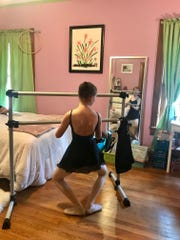 Sylvie Williamson, age 11 doing a plie' in her bedroom while watchiing her teacher on Zoom.