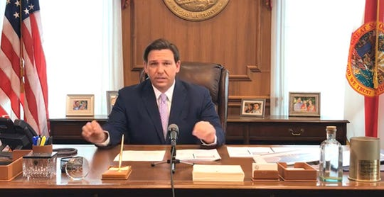 Gov. Ron DeSantis gives an update on the coronavirus from his office on March 24, 2020.