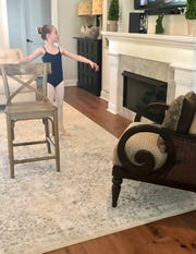 Using the family living room for virtual ballet class with Ballet Arts Conservatory of Tallahassee. Chloe Nolen, 8, is a junior company member attending class three times per week.