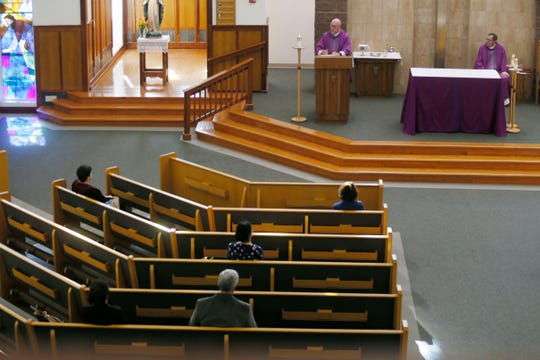 "St. Luke Catholic Church hosts a virtual church services for the fifth Sunday in Lent on March 28 in El Paso, Texas. The church is only allowing 10 people to be in the building during virtual services. St. Luke. along with other Catholic churches in El Paso, has switched to Facebook Live church services during the ""Stay Home, Work Safe"" order."