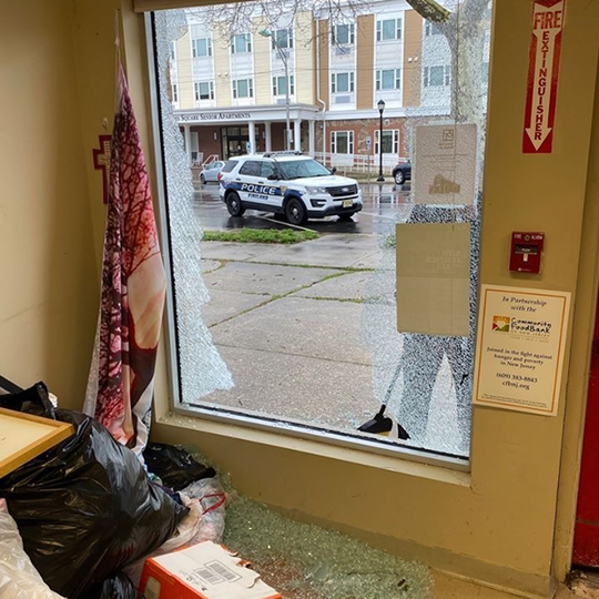 The Vineland Soup Kitchen crew clean up the damage after someone  hurled a rock through the window of their Landis Avenue office.