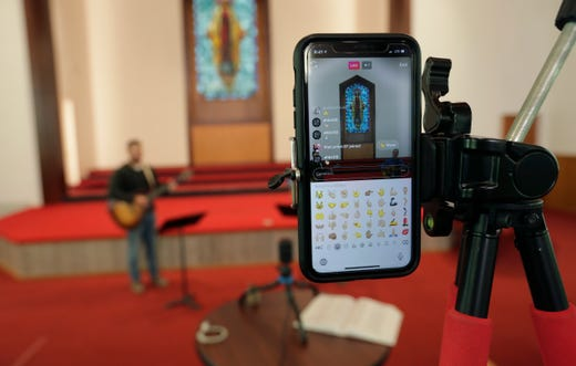 A small staff streams an online service without church goers present at Alamo Height Baptist Church in San Antonio, Texas, Sunday, March 29, 2020. Due to the coronavirus outbreak churches in the area are closed and many are televising services or holding services online.