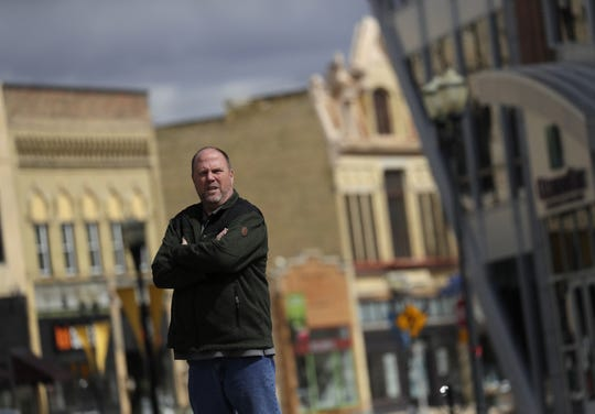 Menasha historian Steve Krueger, shown here downtown, has purchased the Barton pipe organ that was used in the historic Brin theater. The organ is in storage in North Carolina until Krueger can bring it home.