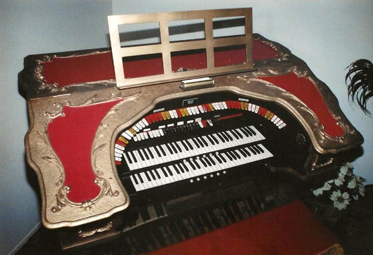The console of the Barton organ is decorated in red and gold.