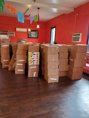 Hundreds of crisis relief boxes were delivered to the Casa de la Tía restauran in Lakewood in advance of a food distribution event to be held on Tuesday, March 31. The food was sent from Fulfill, formerly the FoodBank of Monmouth and Ocean County, to help hundreds of families cope with the coronavirus pandemic.
