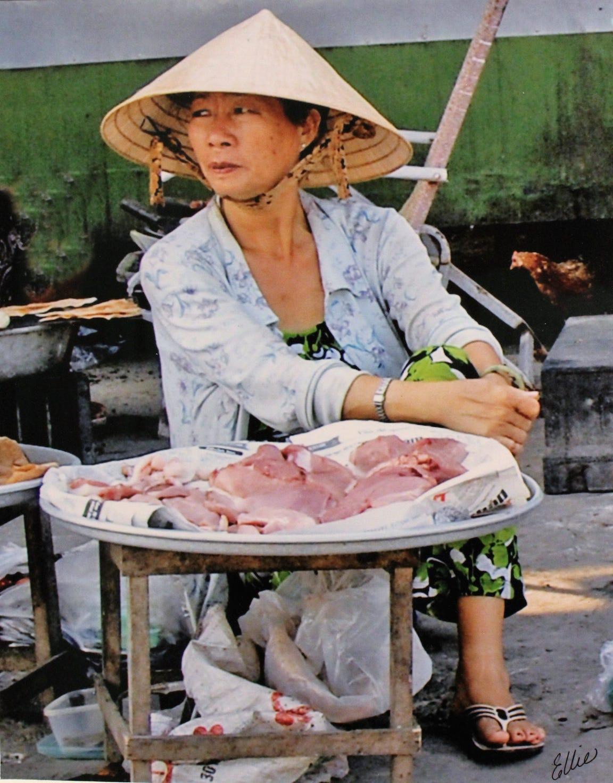 A woman sells meat, Mekong River Delta, Vietnam