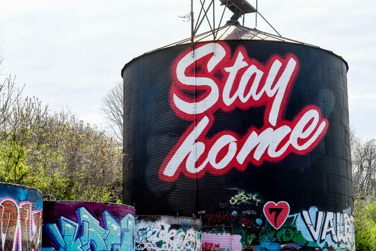 "The silo in the River Arts District is a collaboration by artists Ian the Painter and Ishmael to say, ""Stay home,"" amid the coronavirus. ANGELA WILHELM/AWILHELM@CITIZENTIMES.COM"