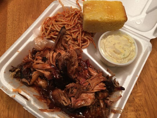 One of the signature items at O.T.'s Up-N-Smoke is the pulled pork with a side of house-made cornbread.