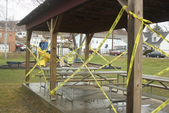 Picnic tables at Northside Park in Johnson City were roped off with caution tape on March 30, 2020.