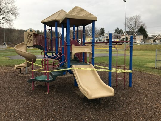 A playground at Fairview Park on Binghamton's East Side was roped off on March 30, 2020.
