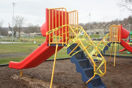 Playground equipment at Northside Park in Johnson City was roped off with caution tape on March 30, 2020.