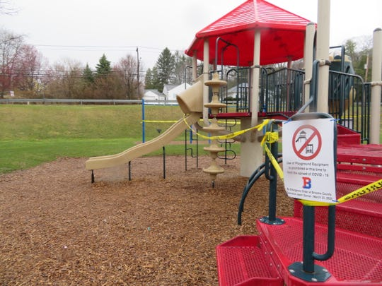 The playground at McArthur Park in Binghamton was roped off on March 30, 2020.