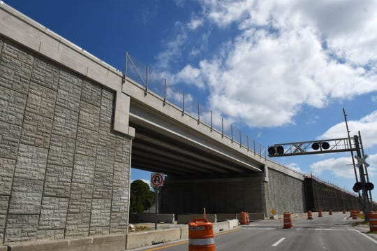 The Pineda Causeway overpass elevates drivers 25 feet above the Florida East Coast Railroad tracks.