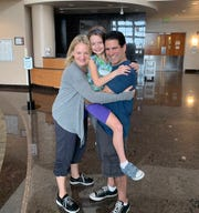Parents Chuck and Kim, with their adopted daughter, Ripley, visit the hospital where the 7-year-old was born, Holmes Regional Medical Center in Melbourne, before being adopted by parents who live in New York.