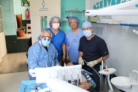 From left: Dr. Haysam Dawood, Teresa Moreno, Alba Taft and Jeremy Moore in the dental clinic at Patzun, Guatemala, where 45 dental procedures were completed during the mission.
