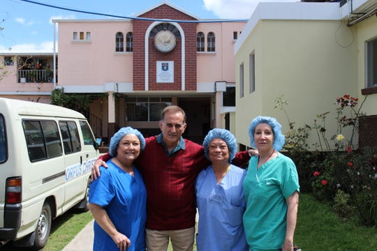 From left:  Teresa Moreno, Guatemalan Vice Minister of Health Dr. Rodolfo Galdamez, Alba Taft and Linda Lawson outside the hospital in Patzun that has become a resource for Guatemalans far beyond Patzun.