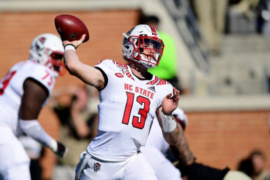 North Carolina State quarterback Devin Leary, a Timber Creek graduate, throws the ball during a game last season.