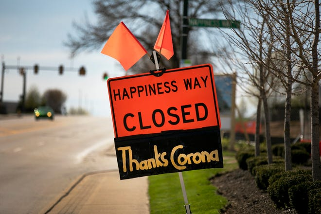 Happiness Way, that runs off Kenwood Rd next to Jewish Hospital is closed due to construction, but someone added something extra to the sign due to the new coronavirus pandemic, Monday, March 30, 2020.