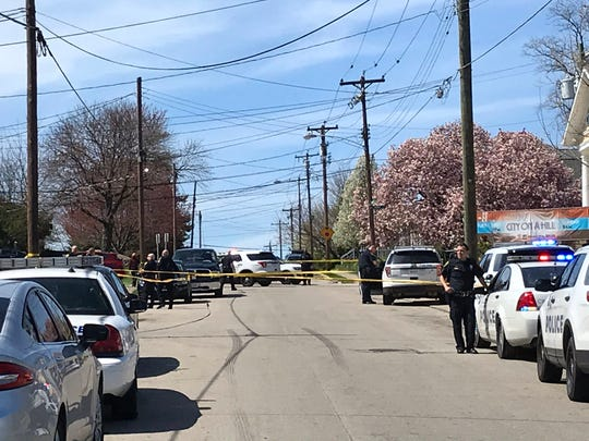 Police investigate a shooting on Mozart Avenue in Westwood Monday.